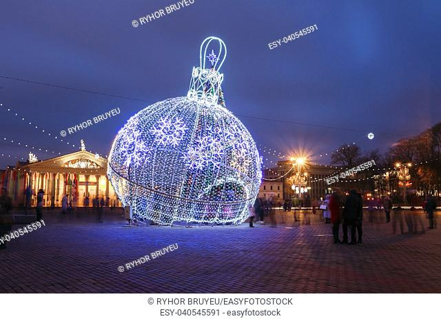 City Christmas illuminations like a large ball Christmas decorations in town Oktyabrskaya Square in central Minsk, Belarus