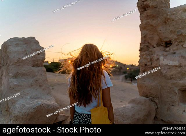 Back view of redheaded woman watching sunset, Fez, Morocco