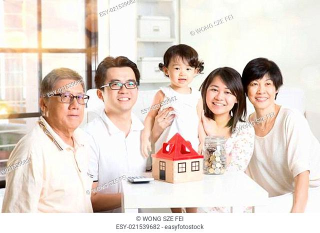 Family future investment or financial planning concept. Asian multi generations lifestyle at home