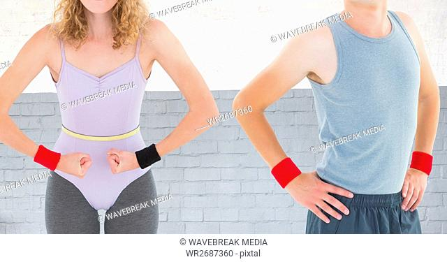 Fitness couple Torso against brick wall