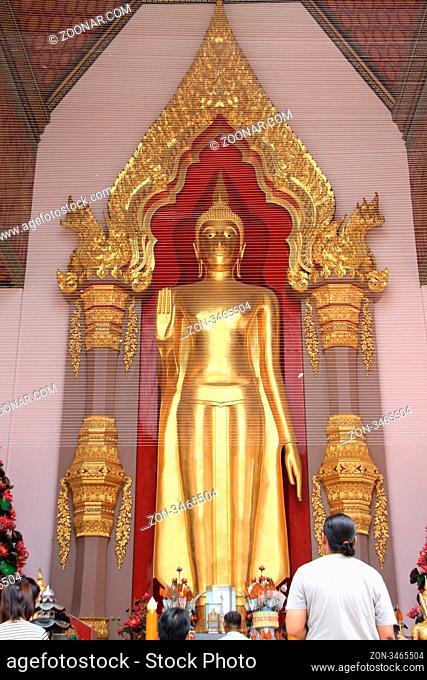 Golden Buddha in temple near Chedi Phra Pathom in Thailand
