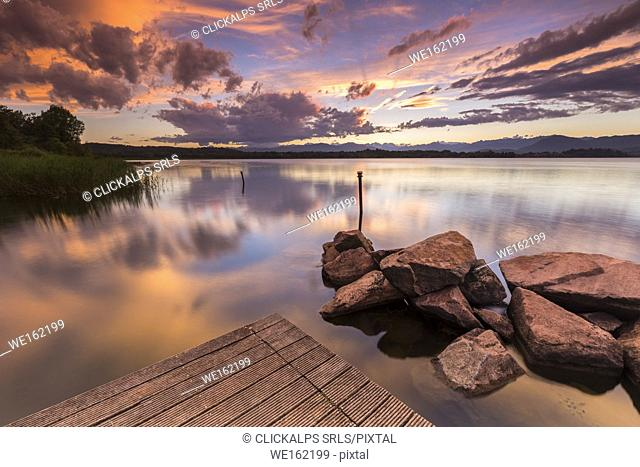 A summer sunset reflecting on Lake Varese at Cazzago Brabbia harbour, Varese Province, Lombardy, Italy