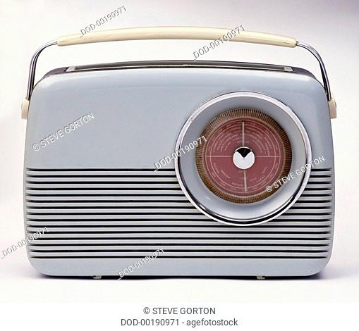 Old fashioned grey plastic and metal portable radio with handle