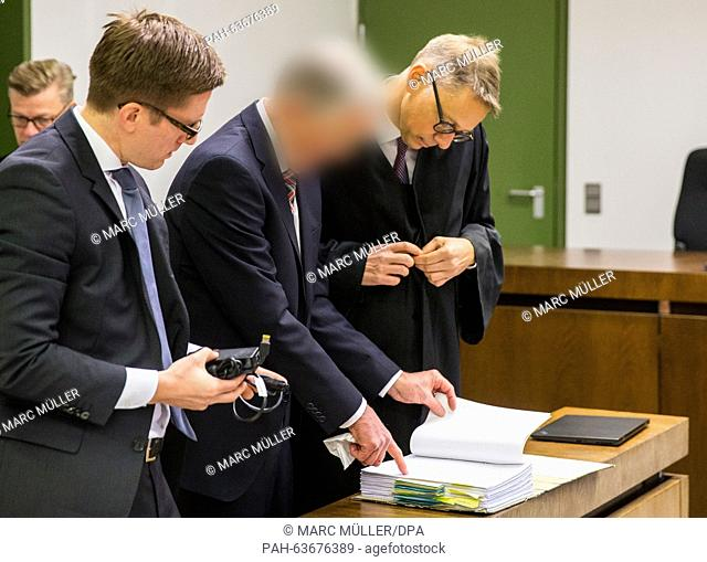 Former manager of German weapons manufacturer KMW (Krauss-Maffei Wegmann) stands next to his lawyers Philipp Falk (L) and Rainer Spatscheck in the dock of a...
