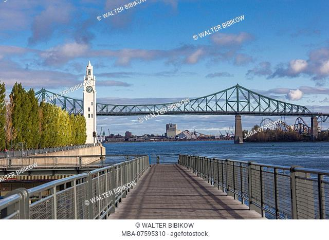 Canada, Quebec, Montreal, The Old Port, Sailor's Memorial Clock Tower and Jacques Cartier Bridge