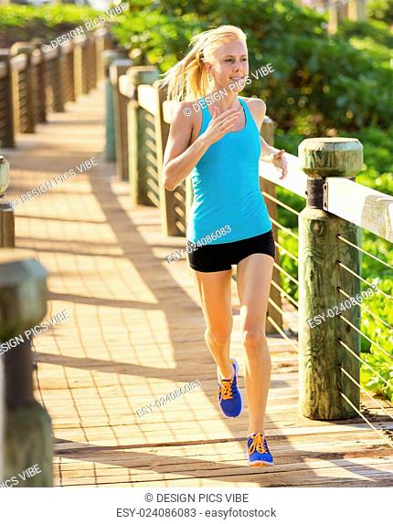 Athletic woman runner outside jogging along path, Healthy lifestyle sports fitness concept