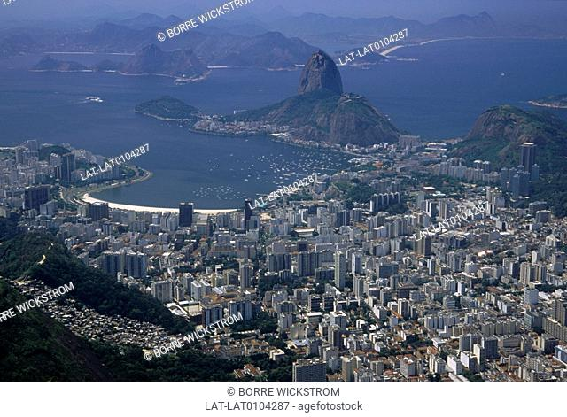 View of Sugar Loaf,Pao de Acucar hill. City landscape. Hills. Districts,woods. Beaches