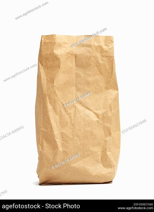 paper disposable bag of brown kraft paper isolated on white background, concept of rejection of plastic packaging, template for designer