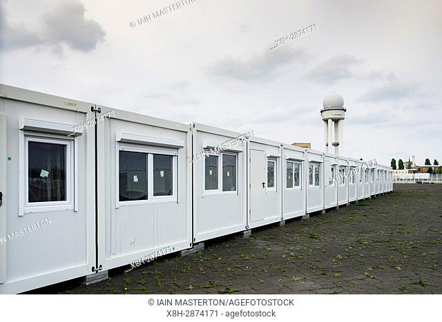 "Berlin, Germany, 6 May 2017. Temporary accomodation for asylum seekers being erected at """"Tempohome"""" in grounds of former Tempelhof Airport in Berlin , Germany"