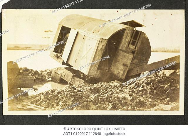 Photograph - A.T. Harman & Sons, Destroyed Excavator Near a River, Victoria, circa 1923, One of five black and white photographs attached to an album page