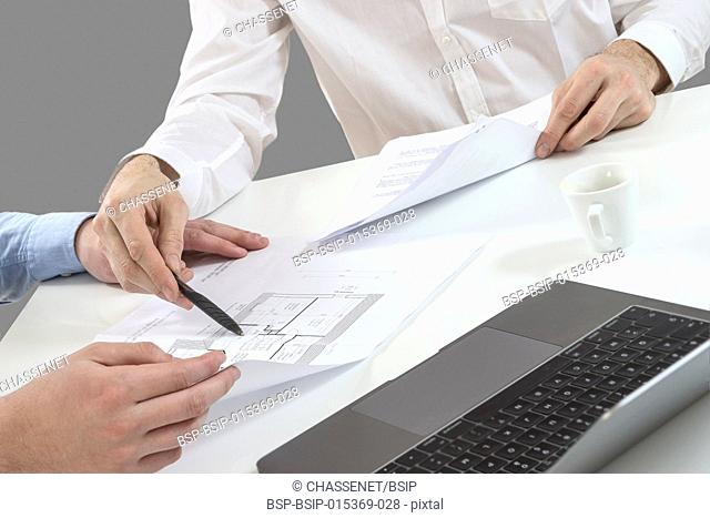 Team of architects working on construction plans in the office