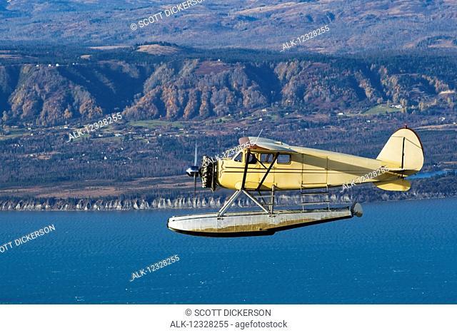 Air-To-Air View Of A 1933 Stinson Jr Sr Over Homer, Kenai Peninsula, Southcentral Alaska, USA