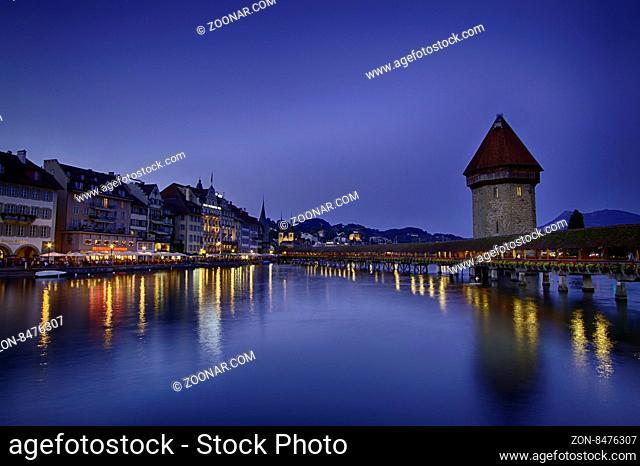Night sight of Chapel Bridge in Lucerne, Switzerland and sky blue