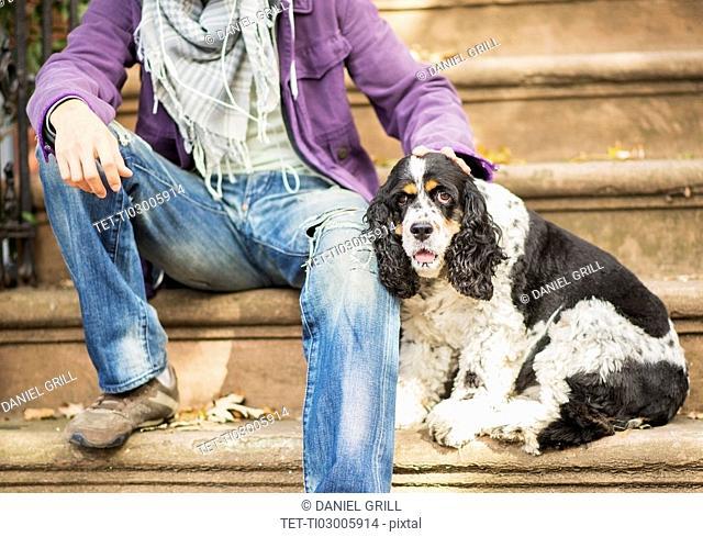 Teenage boy(16-17) with dog