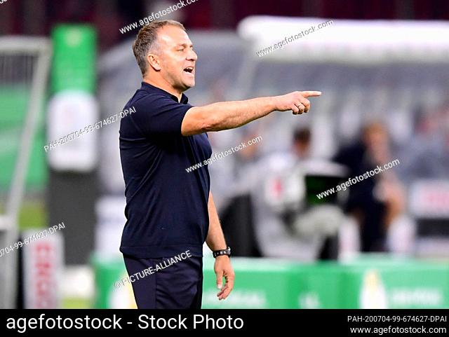 04 July 2020, Berlin: Football: DFB Cup, Final: Bayer Leverkusen - FC Bayern Munich in the Olympic Stadium. Munich coach Hansi Flick gesticulates on the edge of...