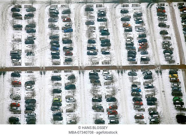 Aerial view, parking lot in the snow OLG with yellow car, Hamm, Ruhr area, North Rhine-Westphalia, Germany, Europe