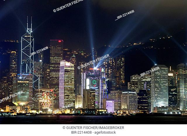 Laser light show on the skyscrapers of the Central District of Hong Kong Island as seen from Kowloon, Hong Kong, China, Asia