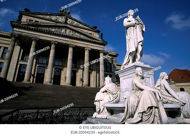 The Friedrich Schiller Memorial statue by Reinhold Begas in front of the former Schauspielhaus now Konzerthaus home of the Berlin Symphony Orchestra