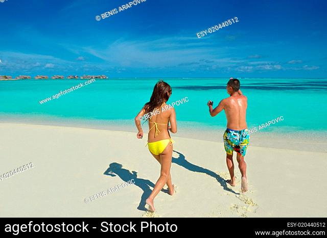 happy young couple enjoying summer on beach
