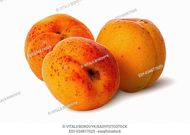 Three juicy ripe apricot isolated on white background
