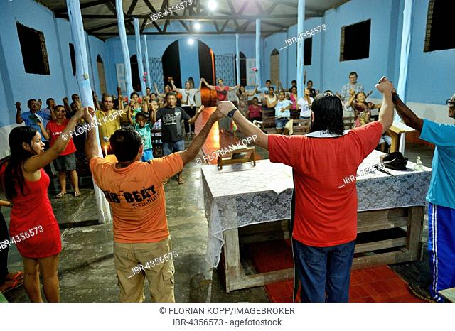 Residents celebrate worship service at the Church of Pimental, district Itaituba, Pará state, Brazil