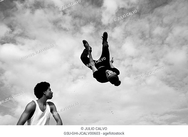 Young Adult Man Flipping Upside Down in Air