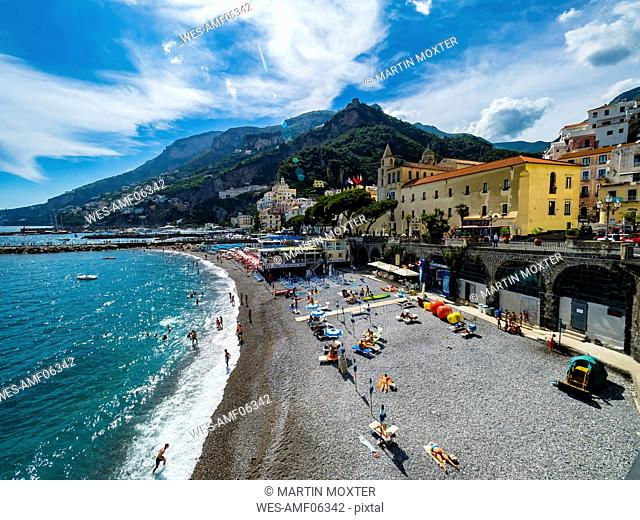 Italy, Amalfi, view to the historic old town with beach in the foreground