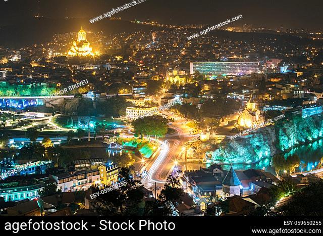 Tbilisi, Georgia. Cityscape In Night Illumination With Famous Landmarks. Rike Park, Holy Trinity Cathedral Or Sameba, Saint George Armenian Cathedral