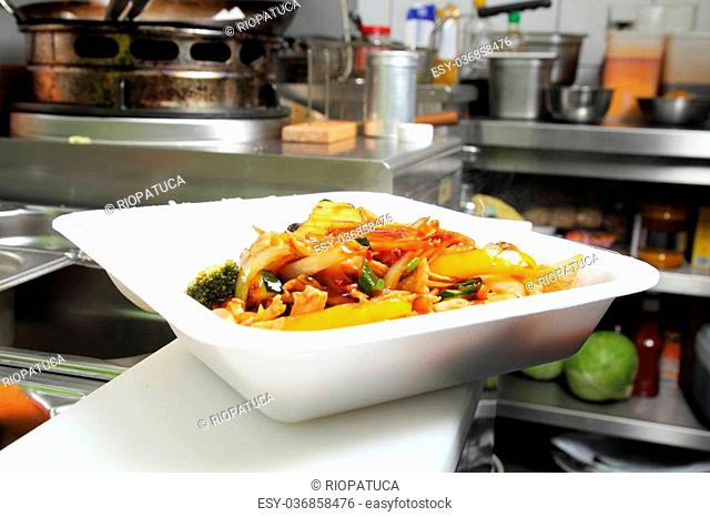 A Asian food in a thermo cup