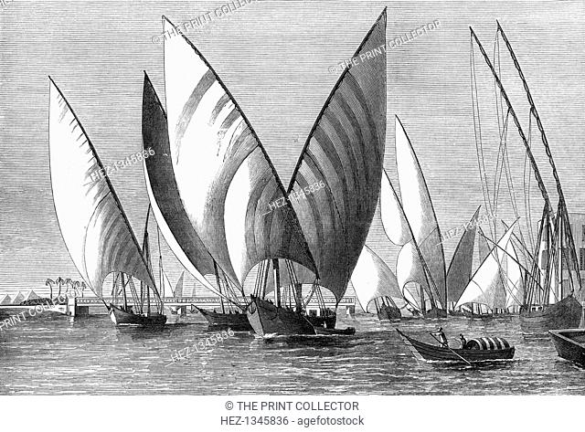 'The River at Boulak Bridge, Cairo, with dahabeahs passing', 1874. Boats on the River Nile. A print from The Illustrated London News, 24th October 1874