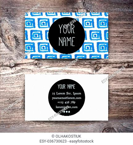 Business card template with watercolor pattern on wooden background