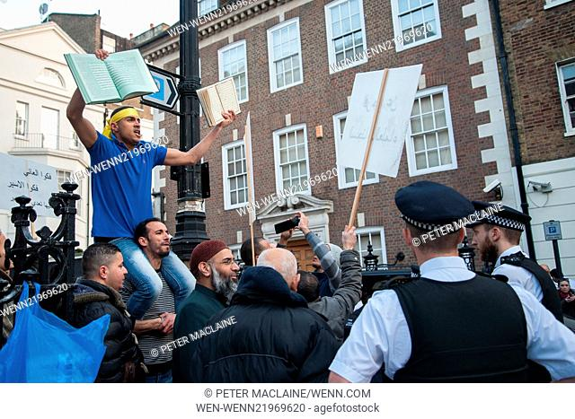 The Britain First candidate, Jayda Fransen who recently took a selfie with presenter, Nick Robinson clashes with Anjem Choudary and his supporters outside the...