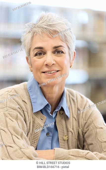 Close up of Caucasian businesswoman smiling