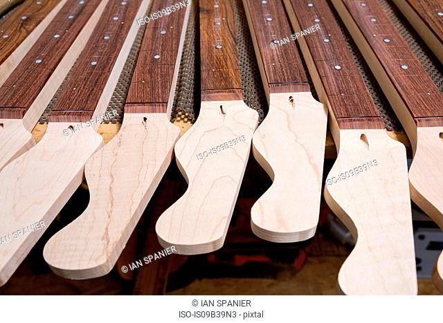 Headstocks and necks of guitars in workshop