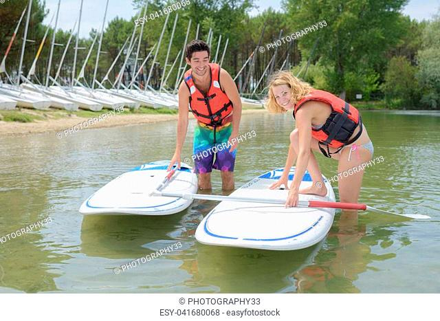 adventurous girl taking a stand up paddle class