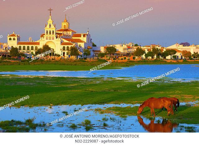 El Rocio village and Hermitage at Sunset, Almonte, El Rocio, Marismas de Doñana, Doñana National Park, Huelva province, Andalusia Spain
