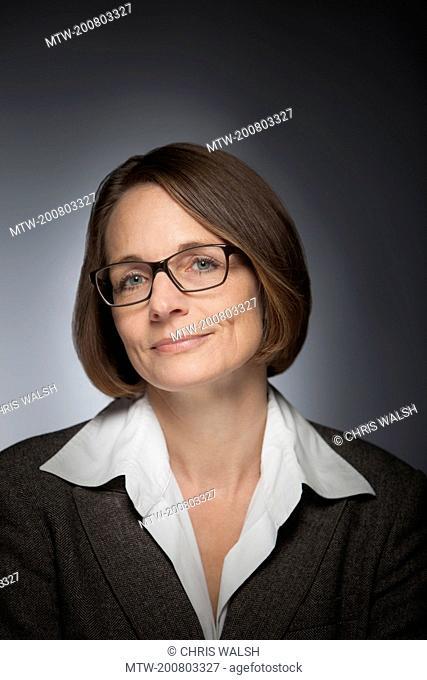 Businesswoman portrait glasses mature middle aged