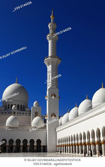 Abu Dhabi, UAE: December 29, 2010: The interior courtyard of the all marble Sheikh Zayed Grand Mosque in the Capital city of the United Arab Emirates