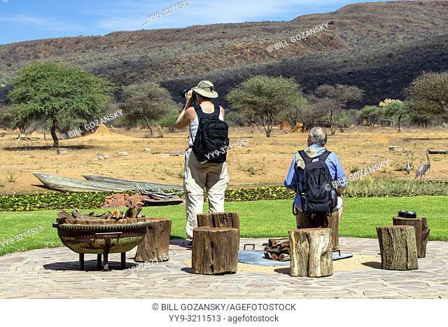 Guests viewing wildlife at Okonjima Bush Camp, Okonjima Nature Reserve, Namibia, Africa