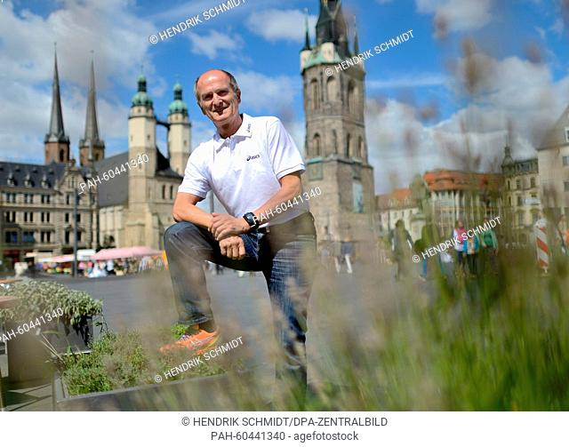 Marathon legend and two-time Olympic gold medalist Waldemar Cierpinski poses on the market square of his home city Halle/Saale, Germany, 28 July 2015