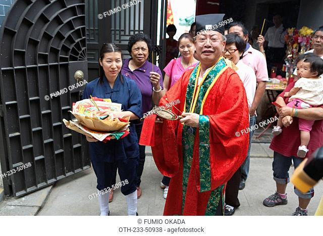 Taoist priest holding a ceremony for the Tin Hau festival at the Big Temple, Joss House Bay, Hong Kong