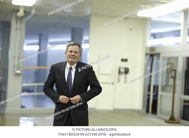 United States Senator Steve Daines, Republican of Montana, walks through the senate subway prior to a vote in the basement of the United States Capitol Building...