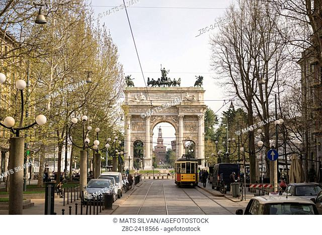 Arco della Pace and Castle Sforza with city view with Tram and cars in Milan, Italy