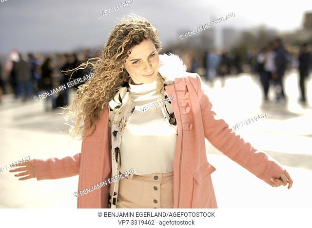 woman outdoors in city, incidental people, at Espl. du Trocadéro, in Paris, France