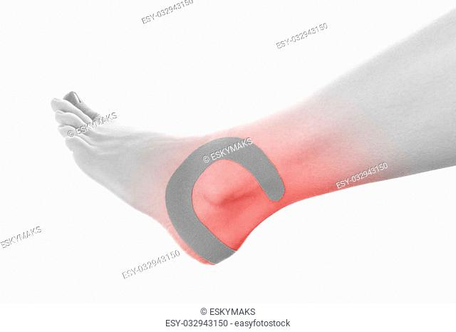 Therapeutic tape on female ankle isolated on white background. Chronic pain, alternative medicine. Rehabilitation and physiotherapy