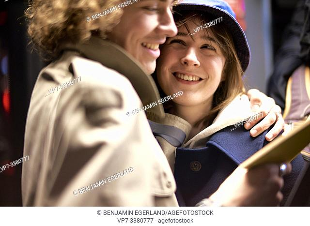 Couple looking at book. Nightlife, in Berlin, Germany