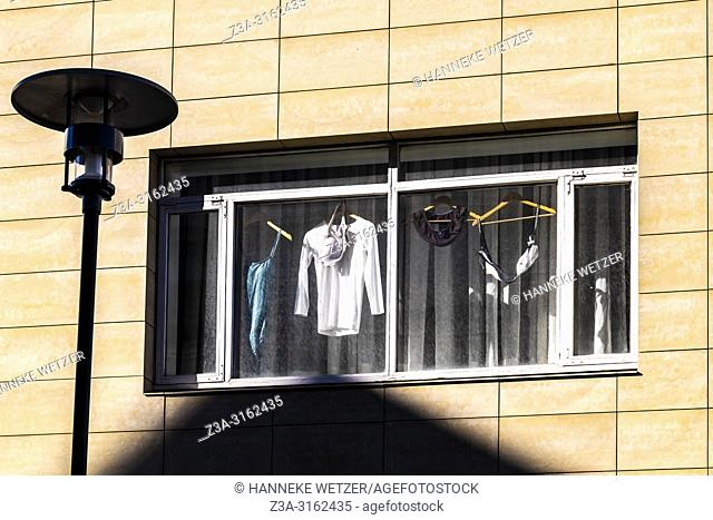 Laundry drying behind a window in Reykjavik city center, Iceland