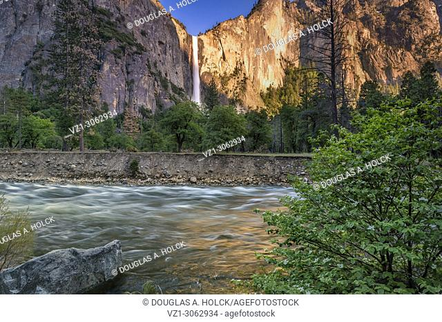 Flowing Merced River passes by Bridalveil Fall on a Spring Day