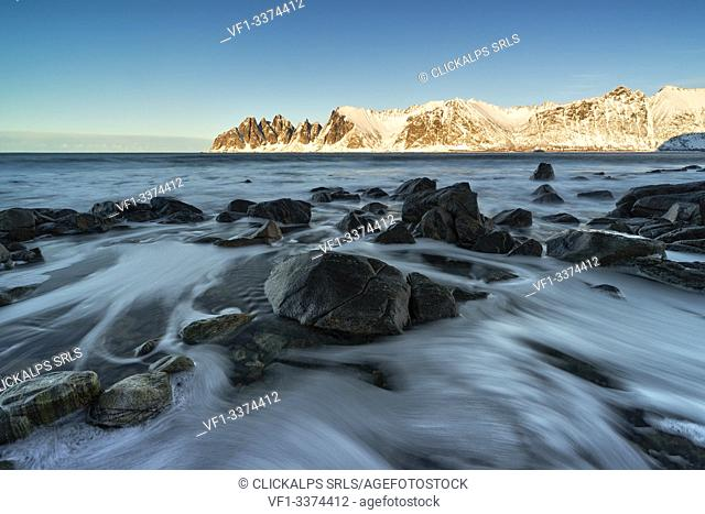 seascape with long exposure, with the Devil's teeth mountain in the background, Ersfjorden, Senja, Northern Norway, Europe
