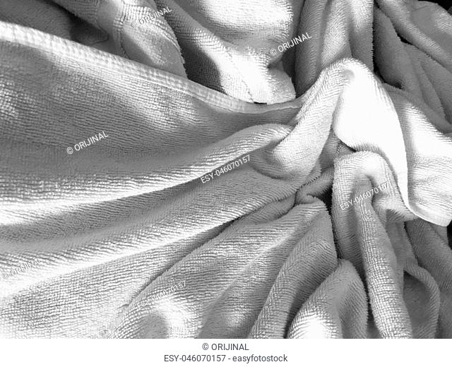White wrinkled fabic texture,Close up unmade bed sheet in the bedroom after night sleep